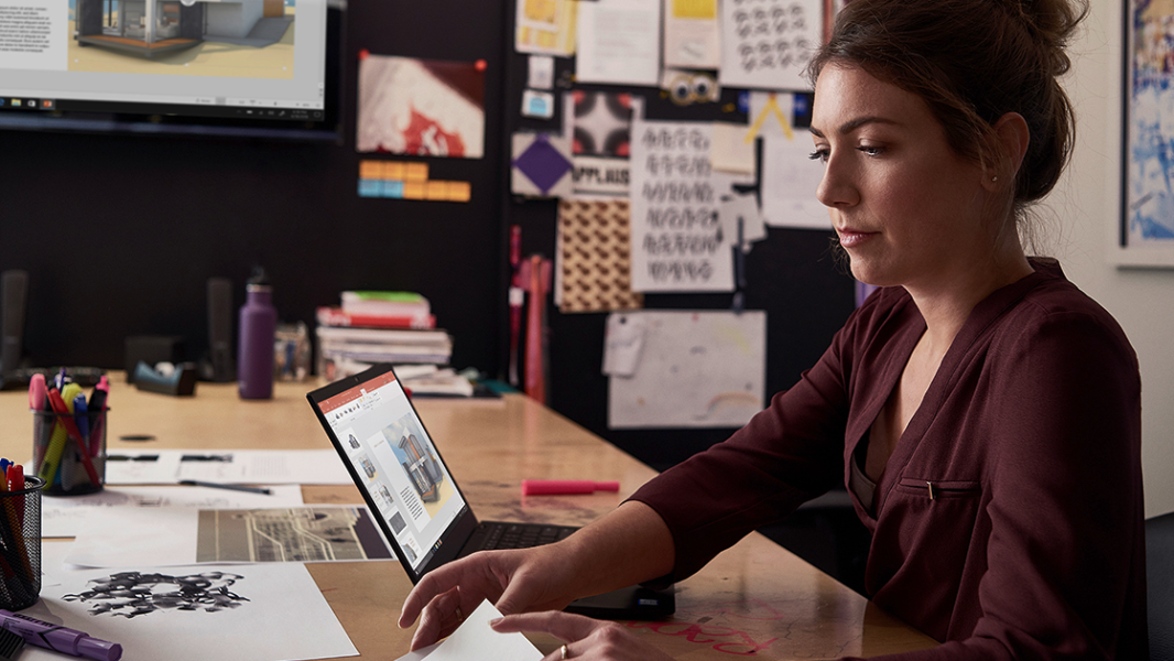 Image of a woman at her desk.
