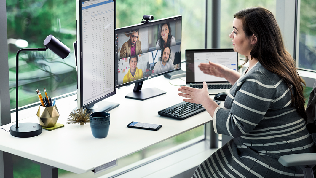 Image showing a woman working at her desk, holding an online meeting.
