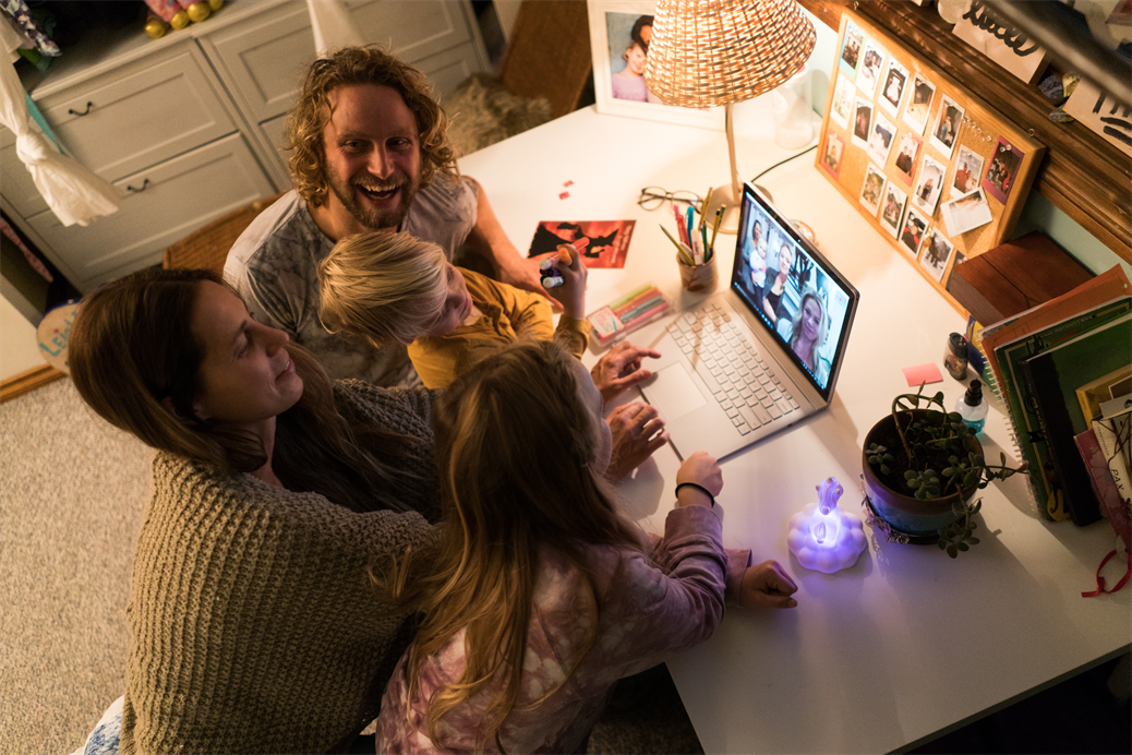 A family using Microsoft Teams to connect with friends or family.