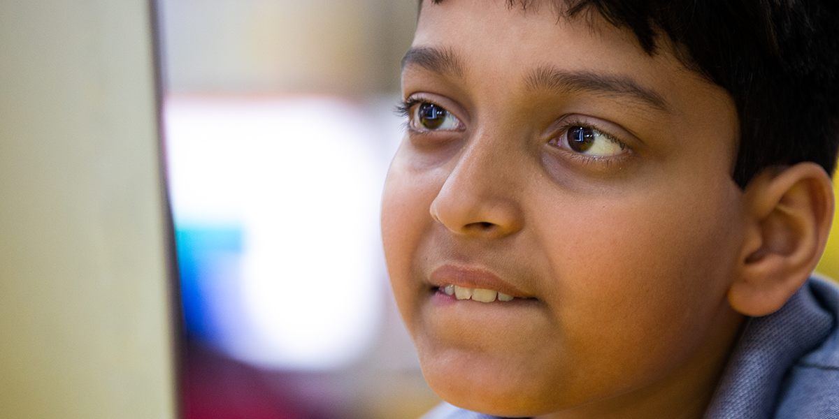 Image of a boy in a classroom.