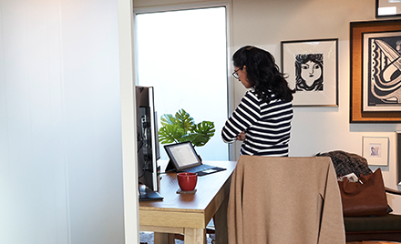 Image of a remote worker in her home.