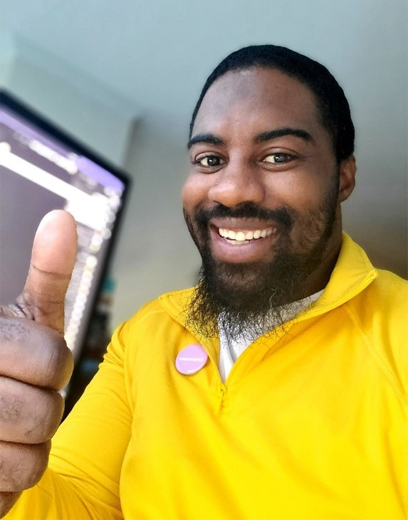 Microsoft Store manager Ethaniel Sinclair works from home in Alexandria, Virginia.