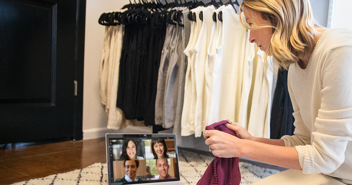 A small business owner shows fabric to her cohorts in a Microsoft Teams meeting.