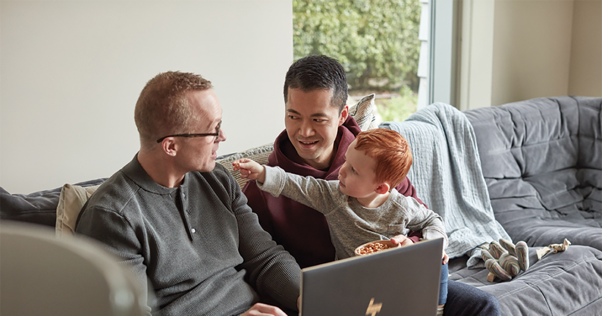 LGBTQ family with fathers and son using HP Spectre X360 15.