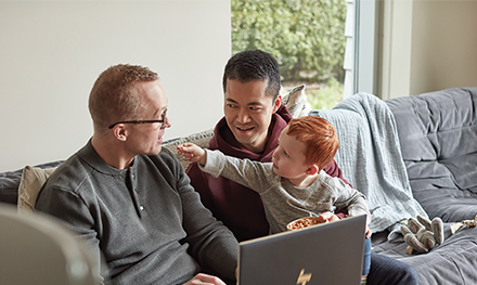 Image for: LGBTQ family with fathers and son using HP Spectre X360 15.