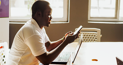An image of an African male founder working in conference room location in Ghana.