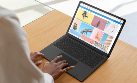 Image for: An image of woman browsing in Edge on Black Surface Laptop 3.