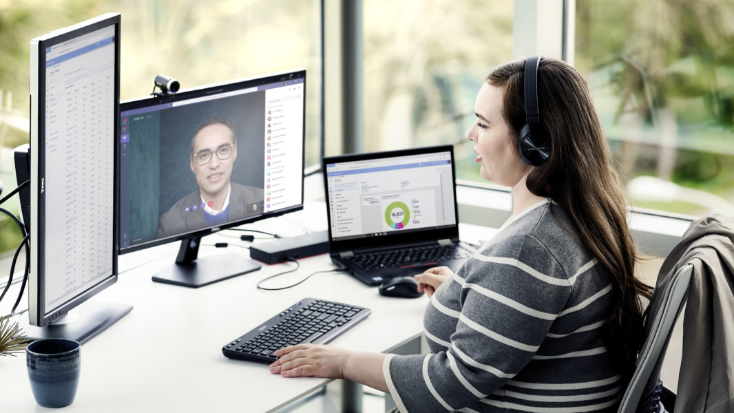 Enterprise employee working remotely from home on a Lenovo device, running Microsoft Teams, Word and Excel