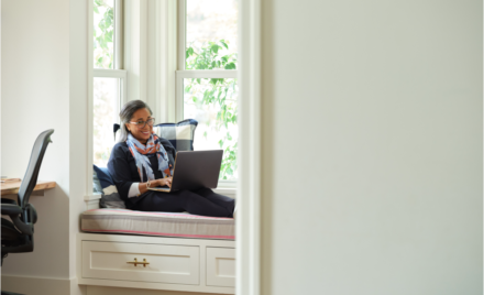 Image for: Woman working in a home office. Microsoft 365 Business Premium Female, home office, owner, collaboration, remote work (1)