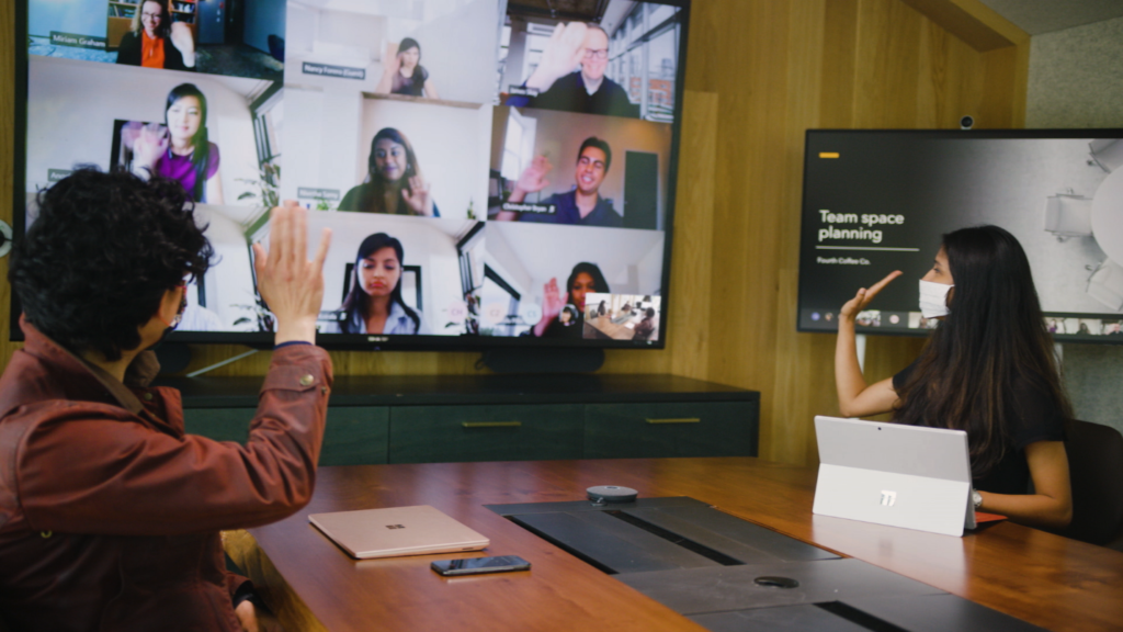 Image showing people collaborating digitally and in-person with Breakout rooms from Microsoft Teams