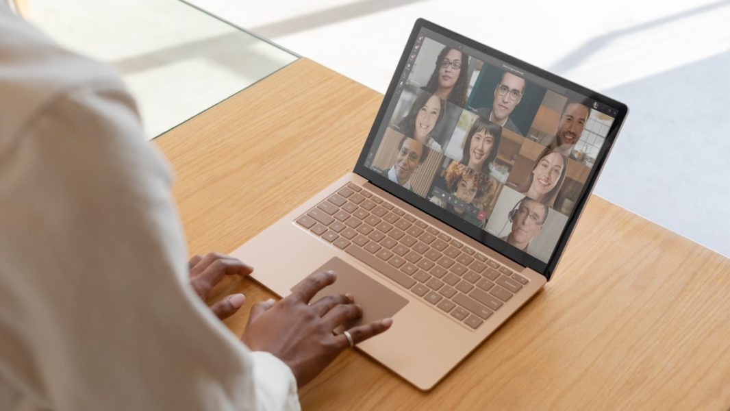 Contextual image of woman on Sandstone Surface Laptop 3 inside.