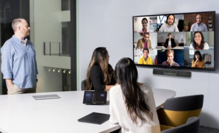 Image for: Image of a team on a Microsoft Teams meeting featured on a big screen