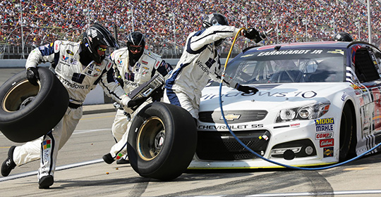 Hendrick Motorsports team performing a pit stop tire change