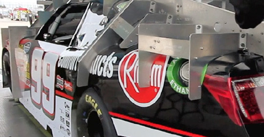 NASCAR car with pre-race inspection devices mounted; Watch the video