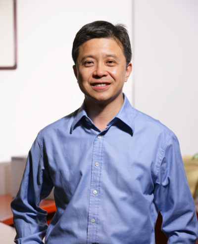 a smiling man in a blue shirt