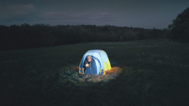 Lighted dome camping tent in the dark night