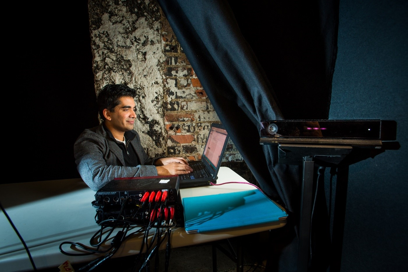"""Microsoft researcher Neel Joshi works on the Kinect-enabled sound system of """"The Oregon Project."""""""
