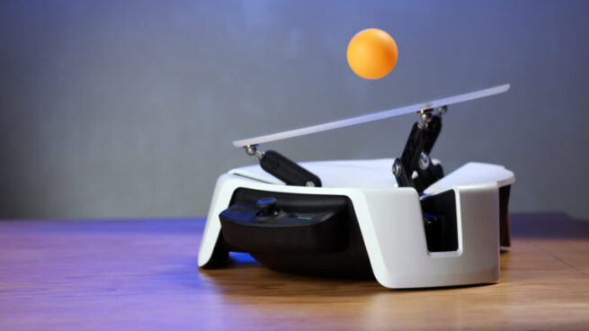 Moab, a ball-balancing robot, is operated using motion control, visualized in simulation on Microsoft Project Bonsai, coordinated using trained Project Bonsai brains, and then deployed to the physical bot.