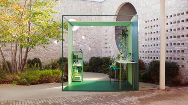 photo of an outdoor courtyard with a green 10x10 box