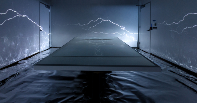 steel blue table in immersive technologies installation