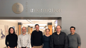 microsoft ability team stands in front of sign at university of texas at austin