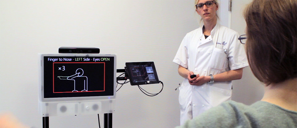 Photo of a patient in front of the ASSESS MS monitor