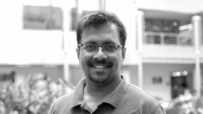 Black and white photo of Karthik Ramachandra
