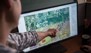 Photo of man pointing to AI environmental mapping software
