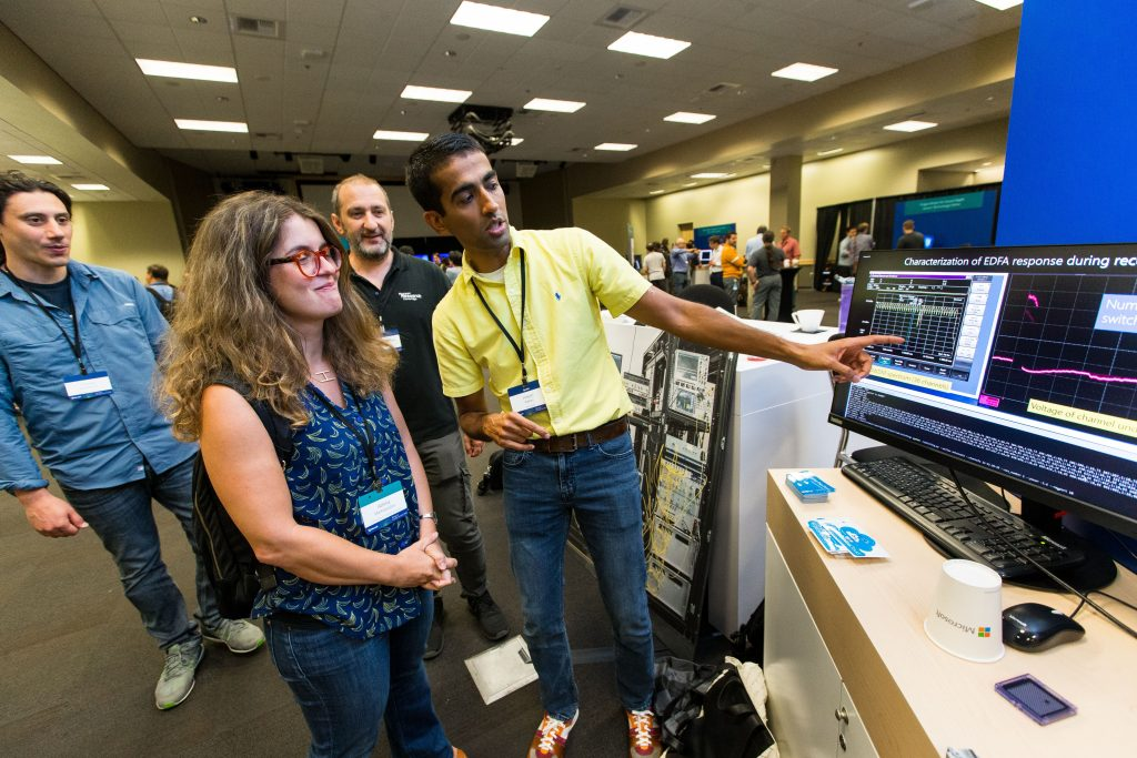 Attendees check out a demonstration during Faculty Summit 2018.