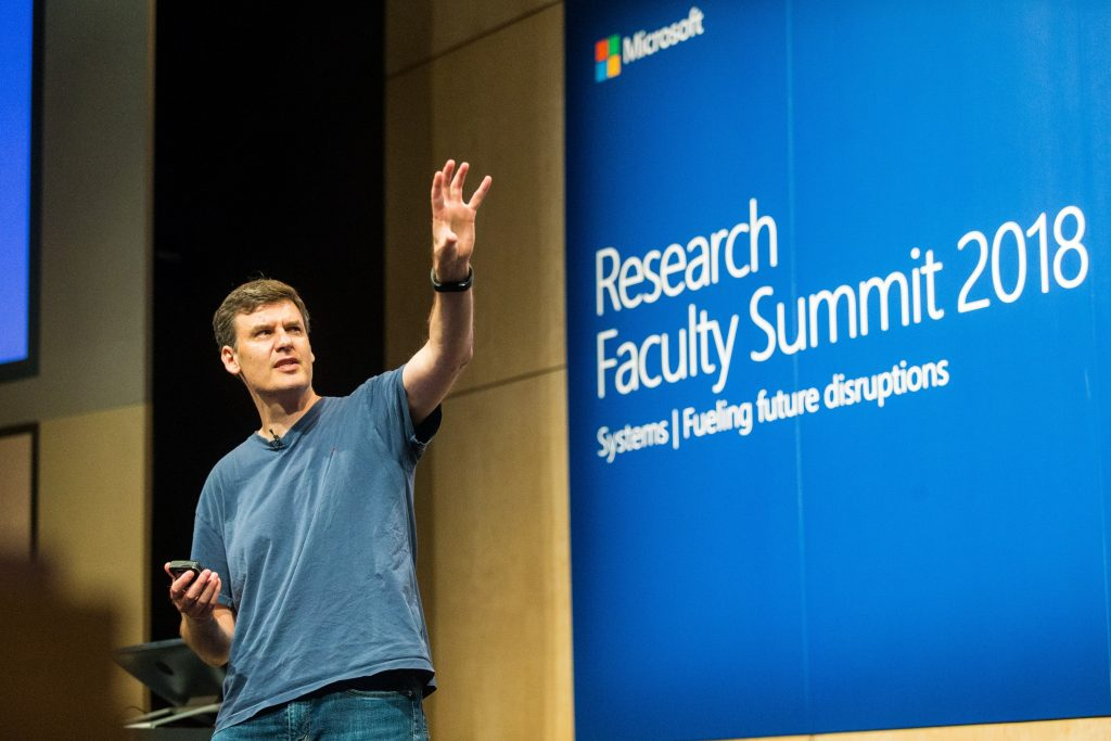 Microsoft's Donald Kossman presenting a talk on systems networking during Faculty Summit 2018.