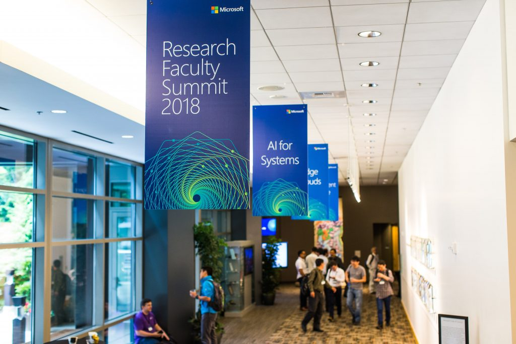 Attendees filing into a lecture room during Faculty Summit 2018.