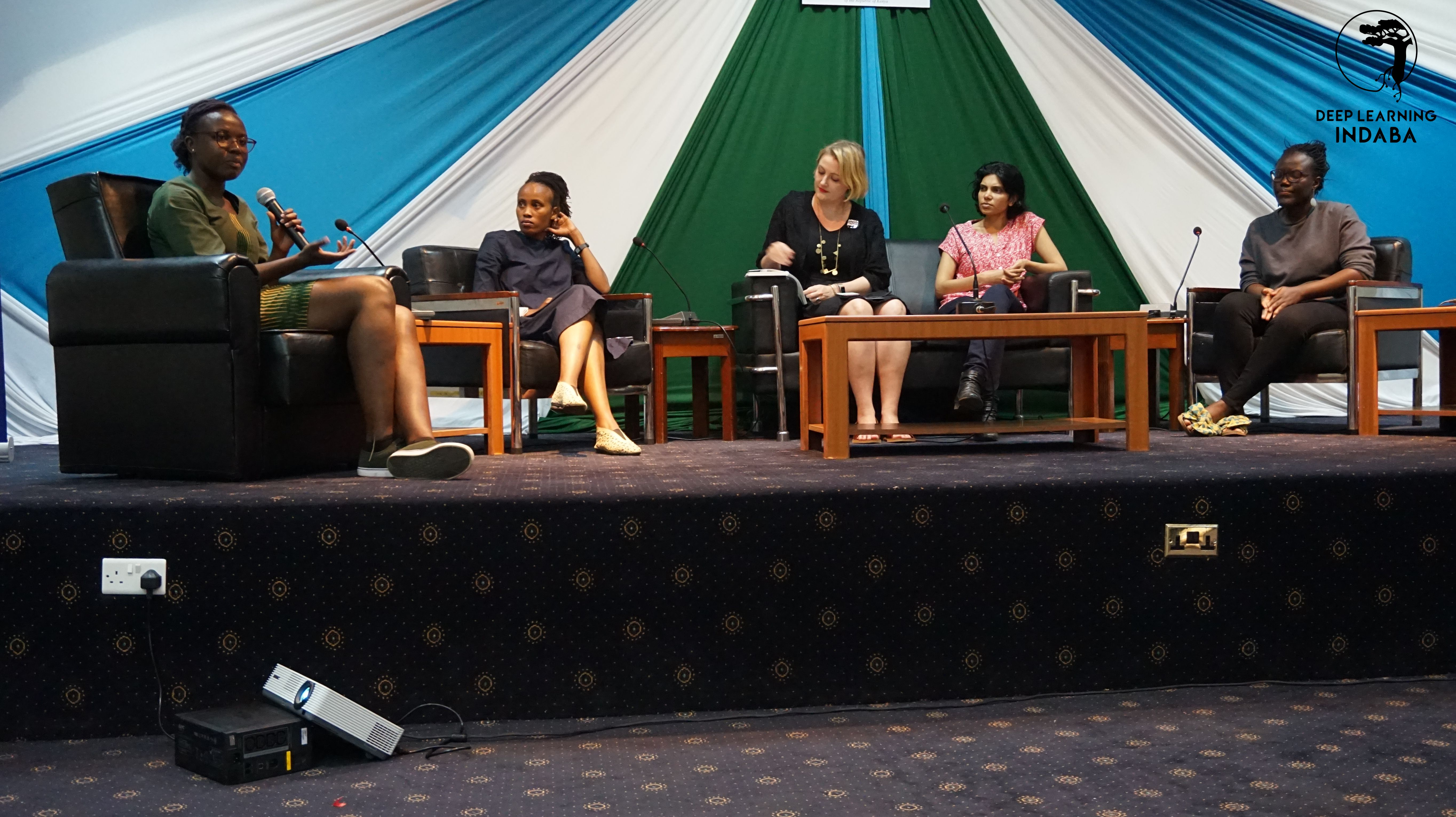 From left to right: Kathleen Siminyu, Grace Mutung'u, Tempest van Schaik, Pashmina Cameron, and Adji Dieng speak about their professional journeys and share advice with attendees during a panel on women in AI during Deep Learning Indaba 2019. Photo credit: Raesetje Sefala and Deep Learning Indaba