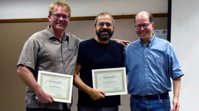 Microsoft researchers Nikolaj Bjørner (left) and Leonardo de Moura (center) received the 2019 Herbrand Award for Distinguished Contributions to Automated Reasoning in recognition of their work in advancing theorem proving. They're pictured with Jürgen Giesl (right) of the award committee.