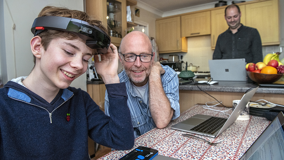 Theo, left, a 12-year-old boy who is blind, interacts with Microsoft senior research software development engineers Tim Regan, middle, and Martin Grayson, right, during user testing of the Project Tokyo system.