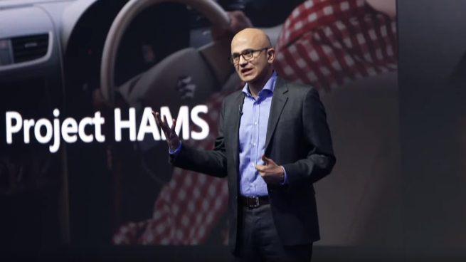 Satya Nadella wearing a suit and tie