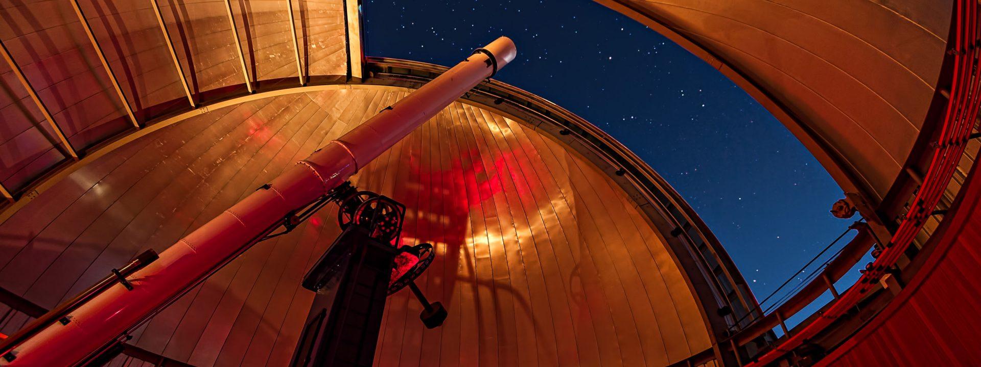 Telescope peering into the night sky