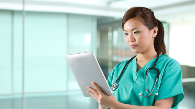 photo of nurse reviewing a tablet