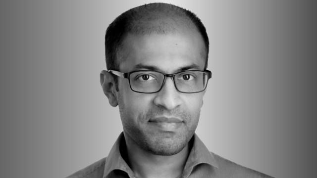 head shot of Dr. Siddhartha Sen for the Microsoft Research Podcast