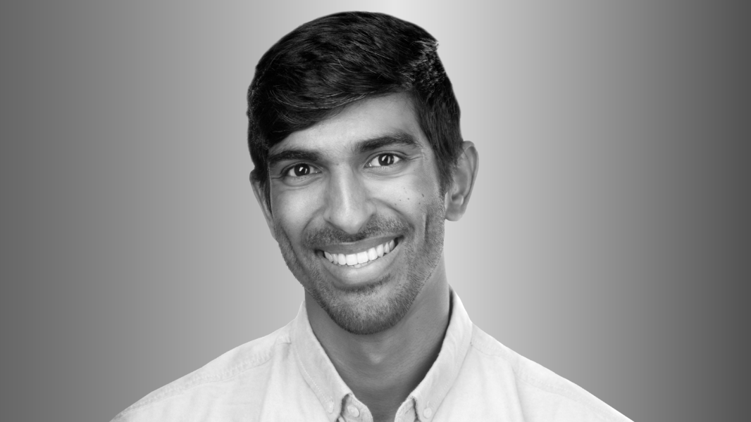 head shot of Dr. Akshay Krishnamurthy for the Microsoft Research podcast
