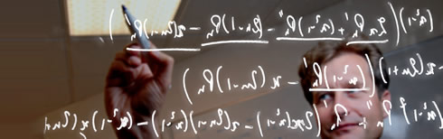 mathematical functions being written on a clear board