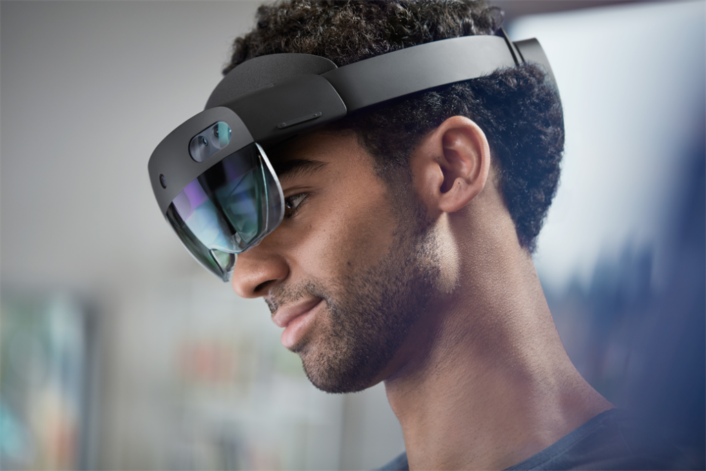 Lifestyle image of male wearing a Hololens 2 device