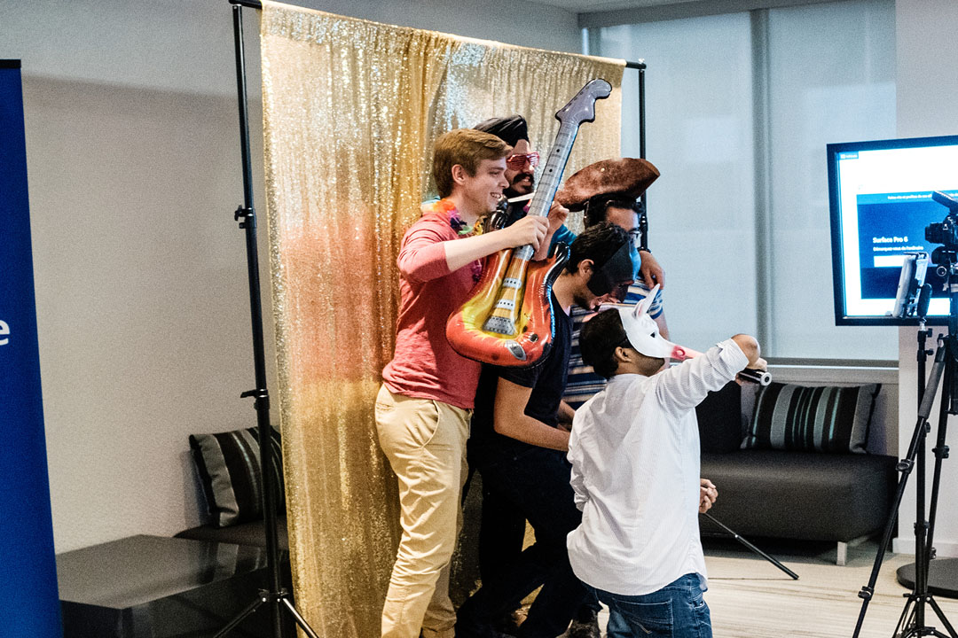Microsoft Research Montreal interns dressing up for a photo in the photo booth. Des stagiaires de Microsoft Research Montréal se dégut en photo dans le photomaton.