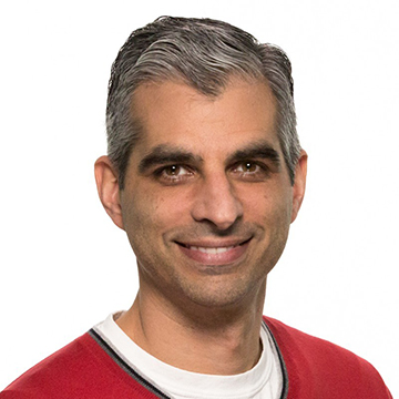 Portrait of Kareem Choudhry from Microsoft and speaker at the Microsoft Research AI and Gaming Research Summit