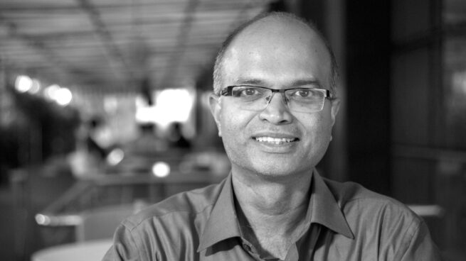 Sriram Rajamani wearing glasses and smiling at the camera