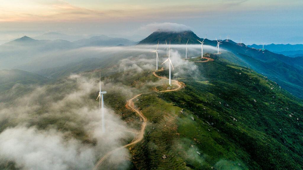 environmental sustainability - a windfarm on a cloudy mountaintop