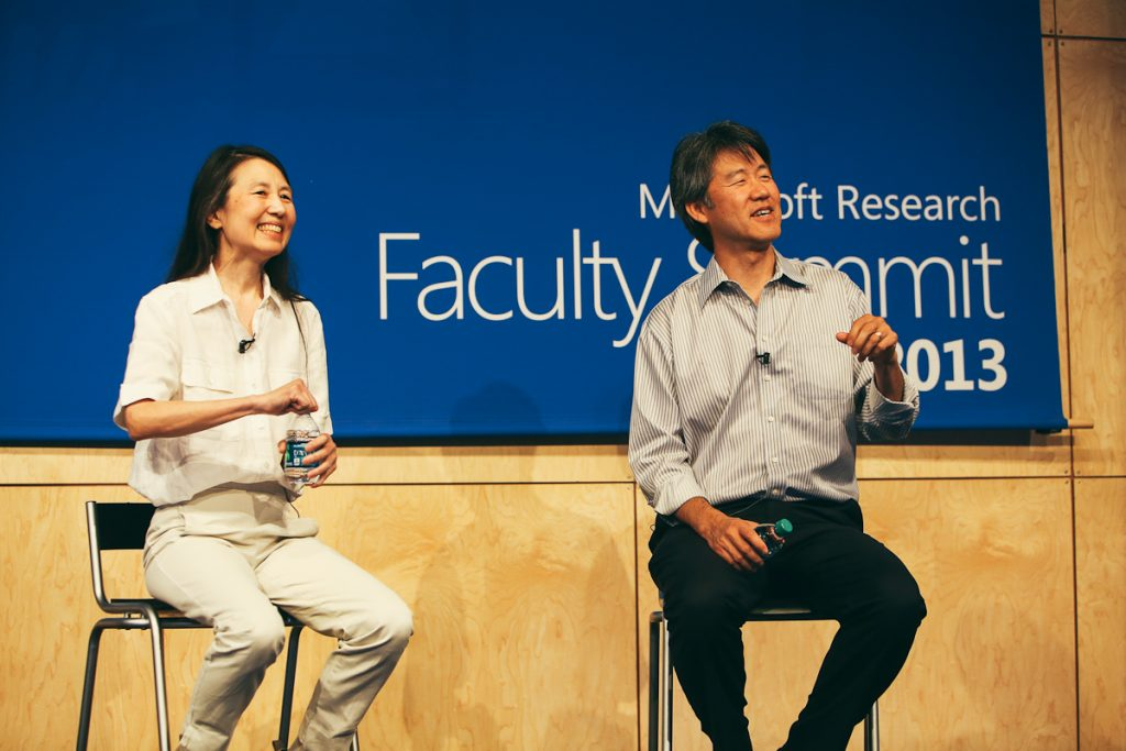 Keynote speakers Peter Lee, corporate vice president and head of Microsoft Research, and Jeannette Wing, Microsoft corporate vice president of Microsoft Research, speak about how basic research helps everyone on July 16 during the Microsoft Research Faculty Summit.