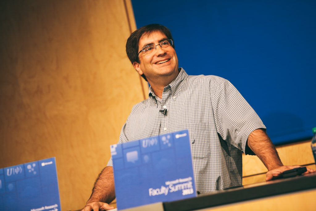 Eric Rudder, executive vice president of Microsoft's Advanced Strategy and Research group, is shown speaking before introducing Bill Gates, Microsoft chairman, who delivered the opening keynote of Microsoft Research Faculty Summit 2013 on July 15.