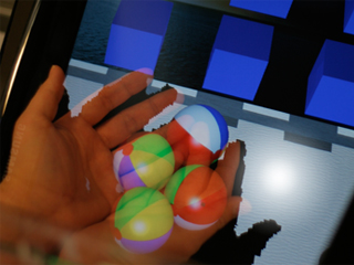 HoloDesk – Direct 3D Interactions with a Situated See-Through Display