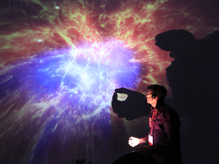 Pinch the Sky Dome: Multi-Point Interactions with Immersive Omnidirectional Visualizations in a Dome