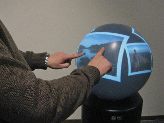 Sphere: Multi-Touch Interactions on a Spherical Display